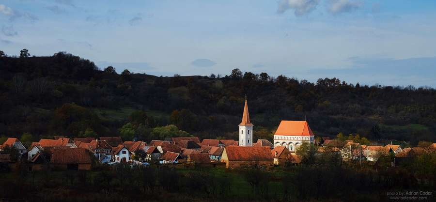 Beautiful light over the church and the small village from Romania